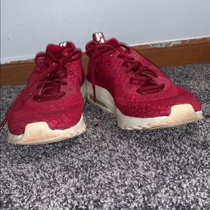 Pink/maroon/red Nike tennis shoes